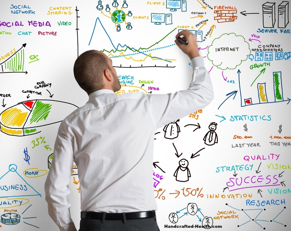 Photo shows man at white board reflecting a presentation like a health & wellness talks.