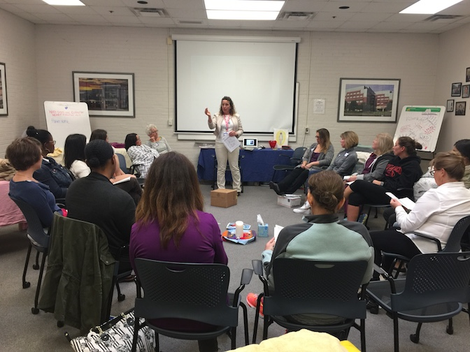 Lucrezia Mangione presenting a Healing Touch training to a group of nurses.