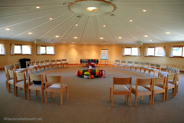 Circle of chairs in a warm beautiful space depicting a relaxed inviting setting for group therapy